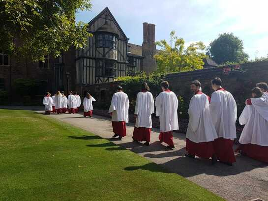 The choir in robes in walnut tree court